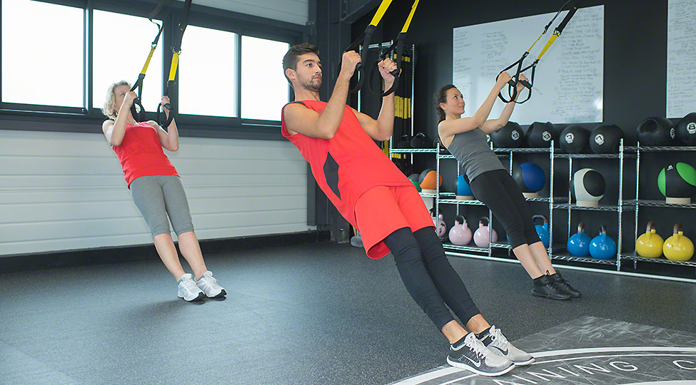 fit young people training hard at the gym – crossfit