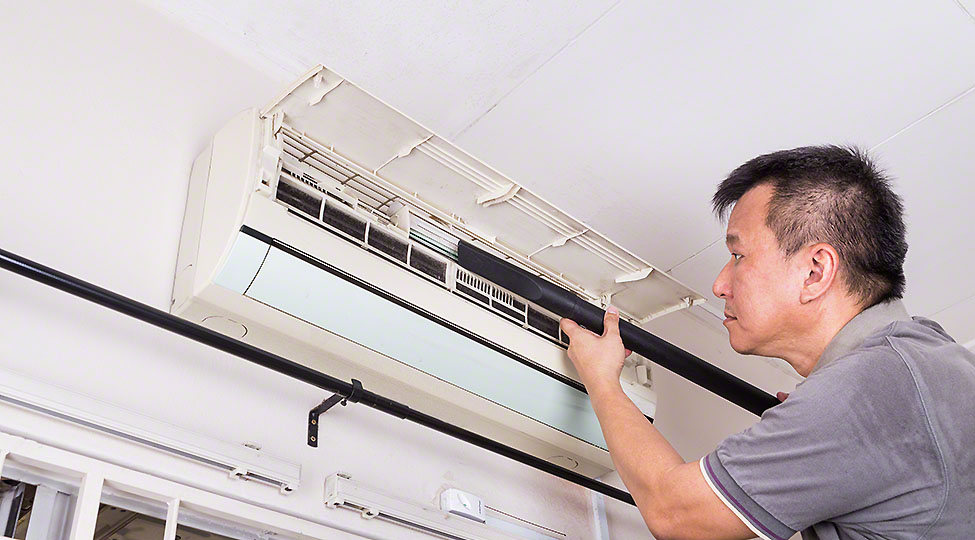 Series of technician servicing the indoor air-conditioning unit.
