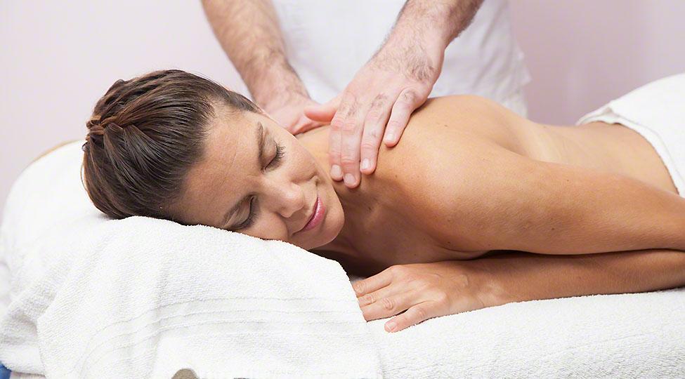 Woman receibing a massage at the spa